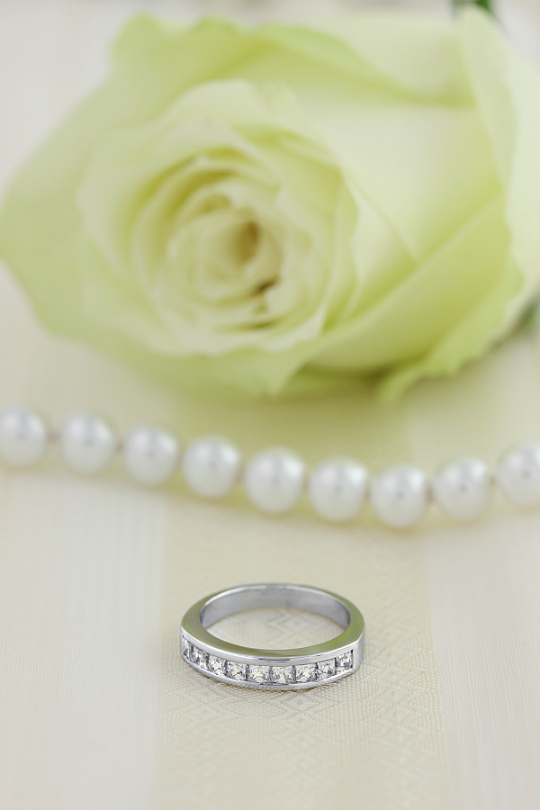 Half Eternity Ring for women in platinum with 9 Princess cut diamonds in channel setting-img1