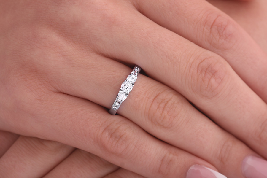 Three Stone Ring with Shoulders/Engagement Ring for women in platinum with 3 round diamonds and diamonds on the shoulders-img1