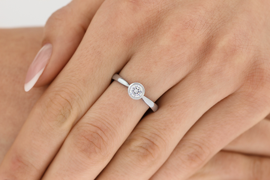Single Stone Engagement Ring for Women in Palladium with a Round Brilliant Diamond in a Rub-over Setting-img1
