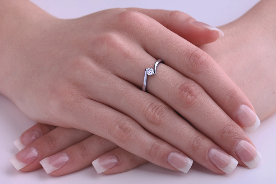 Single Stone Twist Engagement Ring for Women in 9ct White Gold with a Round Diamond in a Tension Setting-img1