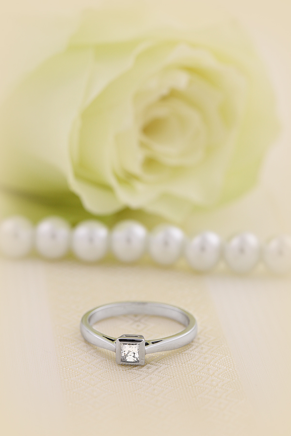 Single Stone Engagement Ring for Women in Platinum with a Princess Cut Diamond in a Rub-over Setting-img1