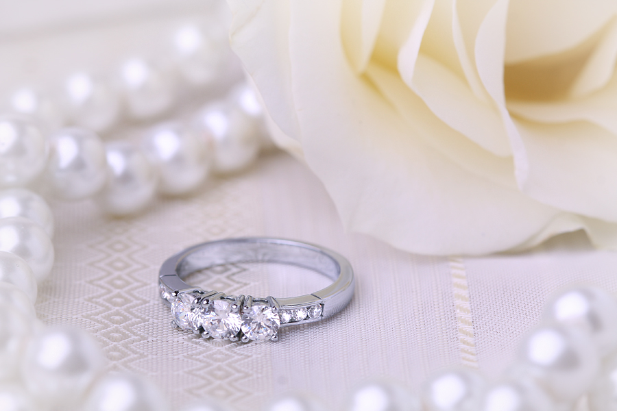 Three Stone Ring with Shoulder/Engagement Ring for women in platinum with 3 round diamonds and round diamonds on the shoulders-img1