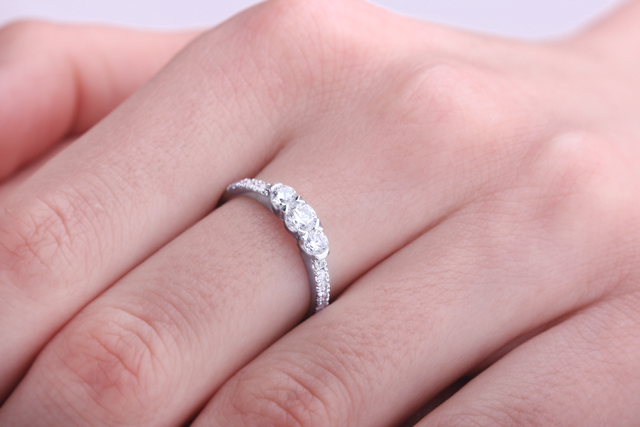 Three Stone Ring with Shoulders/Engagement Ring for women in 18ct white gold with 3 round diamonds & round diamonds on the shoulders-img1
