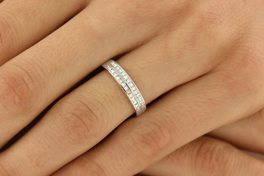 Half Eternity Ring/Dress Cocktail Ring for women in 18ct white gold with princess cut diamonds arranged over 2 rows-img1